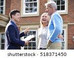 realtor showing mature couple... | Shutterstock . vector #518371450
