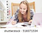 teenage girl using laptop to do ...   Shutterstock . vector #518371534