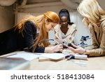 group of designers working on a ... | Shutterstock . vector #518413084