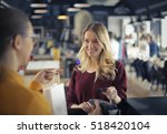 girl at the counter paying by... | Shutterstock . vector #518420104