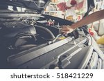 mechanic open the cover of... | Shutterstock . vector #518421229