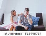 wife comforting husband ... | Shutterstock . vector #518445784