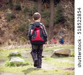 Child With Back Pack Walking O...