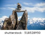 Small photo of Stones cairn bridging gap near Eggishorn peak, Alps, Switzerland