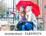 young women reaching snowflakes ... | Shutterstock . vector #518559574