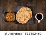 roti parata or roti canai with... | Shutterstock . vector #518562460