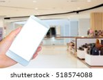 hand holding the white... | Shutterstock . vector #518574088