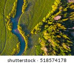 Aerial View Of Green Meadow An...