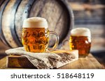 two glasses full of beer with... | Shutterstock . vector #518648119