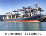 loading cargo ship in port | Shutterstock . vector #518688340