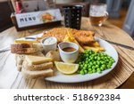 a typical fish and chips meal... | Shutterstock . vector #518692384