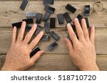 Hands Mixing Domino Game Chips