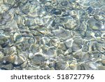 sea water pebbles and rocks on... | Shutterstock . vector #518727796