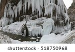Frozen beautiful waterfall in winter. Icicles and mountain river.