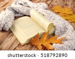 autumn composition with book on ... | Shutterstock . vector #518792890