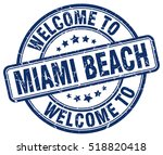 welcome to miami beach. stamp.   Shutterstock .eps vector #518820418