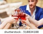 friends drinking wine on the... | Shutterstock . vector #518834188