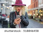 woman looking at her phone in... | Shutterstock . vector #518846458