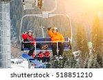 Skier And Snowboarder Riding U...
