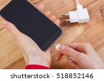 hand of woman connects plug of... | Shutterstock . vector #518852146