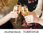 hands holding the glasses of... | Shutterstock . vector #518853418