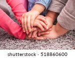 cute kids hands together on... | Shutterstock . vector #518860600