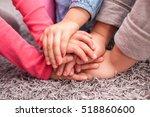 cute kids hands together on... | Shutterstock . vector #518860600