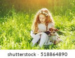 little girl reading a book with ... | Shutterstock . vector #518864890