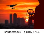 silhouette of man using drone... | Shutterstock . vector #518877718
