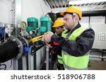 two workers fixing pipes with... | Shutterstock . vector #518906788