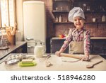 Cute Little Girl In Apron And...