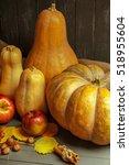 pumpkins on wooden board   Shutterstock . vector #518955604