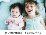 two little sisters together.... | Shutterstock . vector #518967448