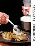 male chef garnishing his dish ...   Shutterstock . vector #518977180
