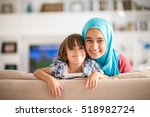 young woman with little kid at... | Shutterstock . vector #518982724