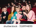 happy family in the movie | Shutterstock . vector #518994850