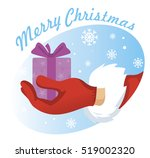hand santa with a gift against... | Shutterstock .eps vector #519002320
