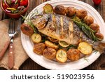 grilled fish with roasted... | Shutterstock . vector #519023956