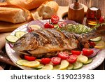 grilled fish with baguette and... | Shutterstock . vector #519023983