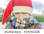 closeup of boy wearing santa... | Shutterstock . vector #519042328