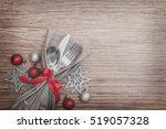 christmas meal table setting... | Shutterstock . vector #519057328
