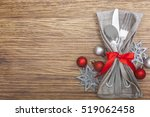 christmas meal table setting... | Shutterstock . vector #519062458