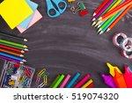 school supplies on blackboard... | Shutterstock . vector #519074320