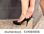 Small photo of cropped shot of a woman wearing stilettos and touching her heel by she has pain in her achilles heel.