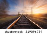 railroad in motion at sunset.... | Shutterstock . vector #519096754