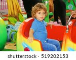 happy smilling boy in amusement ... | Shutterstock . vector #519202153