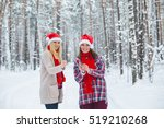 two girls in christmas hats... | Shutterstock . vector #519210268