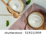 plain yogurt in wooden bowl on... | Shutterstock . vector #519211909