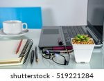 Small photo of Succulent pots, laptop & coffee cup at home office / Interior landscape plants decoration for air pollution abatement concept