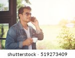 hipster man holding a cup of...   Shutterstock . vector #519273409